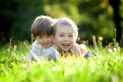 Brother and sister in grass Stock Photography