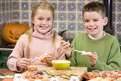 Brother and sister at Halloween making treats Stock Photography