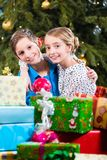Brother and sister during handing out of presents, wishing Merry. Christmas Stock Photography
