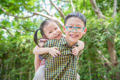 Brother and sister have fun in park Stock Images