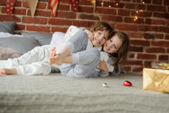 Brother and sister have put up cheerful fight on big bed. Stock Image