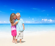 Brother and Sister Having Fun on the Beach Royalty Free Stock Photography