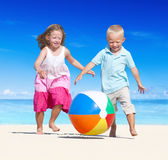 Brother and Sister Having Fun on the Beach Royalty Free Stock Photos