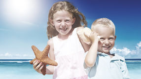 Brother and Sister having fun on the Beach Concept Stock Photos