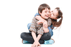 Brother and sister having fun on the floor Stock Photography