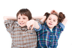 Brother and sister having fun on the floor Stock Image