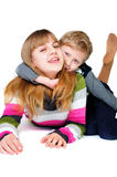 Brother and sister having fun over the white Royalty Free Stock Photography