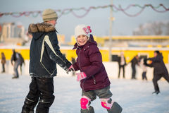 Brother and sister having fun skating Royalty Free Stock Photos