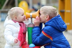 Brother and sister having fun together at playground stock photos