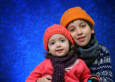 Brother and sister having fun in winter Royalty Free Stock Image