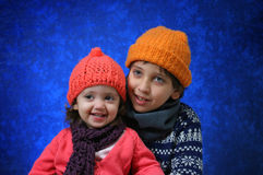 Brother and sister having fun in winter Stock Image