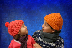 Brother and sister having fun in winter Stock Photography