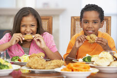 Brother And Sister Having Lunch At Home Royalty Free Stock Photography