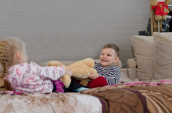 Brother and sister having a tug of war Royalty Free Stock Photos