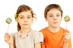 Brother and sister hold lollipops Stock Image