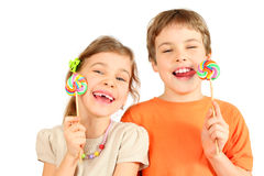 Brother and sister hold lollipops Stock Images