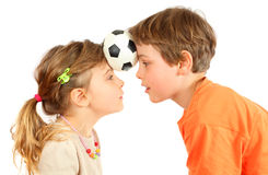 Brother and sister hold their heads ball Stock Photos