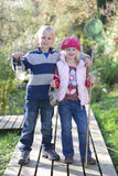 Brother and sister holding bug net and specimen jar outdoors Royalty Free Stock Photo