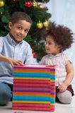 Brother and sister holding Christmas gifts Stock Image