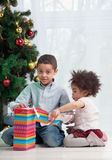 Brother and sister holding Christmas gifts Stock Images