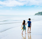 Brother sister holding hand walk on the beach Stock Photo