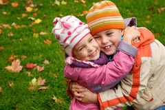 Brother and sister hugging Stock Photos