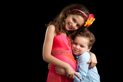 Brother and Sister Hugging. On solid background Stock Photos