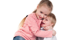 Brother and sister hugging in studio Stock Photography