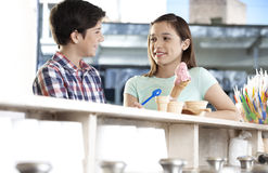 Brother And Sister With Ice Cream Looking At Each Other Stock Photography