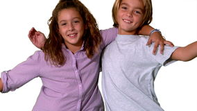 Brother and sister jumping into same shot and embracing Stock Images