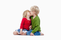 Brother and sister kissing. Children - brother and sister kissing each other - isolated on white Stock Photography