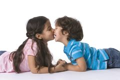 Brother And Sister Kissing Each Other. Lying On The Floor Royalty Free Stock Photos
