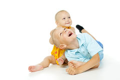Brother and sister are laying on a floor Royalty Free Stock Image