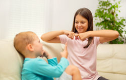 Brother and sister learn sign language Stock Images