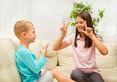 Brother and sister learn sign language Royalty Free Stock Image