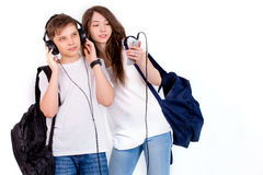 In Brother and sister listen to music with headphones. The joy of this day was just filled with guys, all worked out in the best way Stock Photos