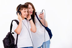 In Brother and sister listen to music with headphones. The joy of this day was just filled with guys, all worked out in the best way Royalty Free Stock Photos