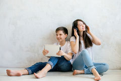 In Brother and sister listen to music with headphones. The joy of this day was just filled with guys, all worked out in the best way Stock Photo