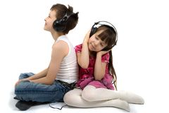 Brother And Sister Listening To Headphones Stock Image