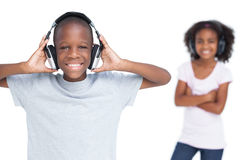 Brother and sister listening to music Royalty Free Stock Images