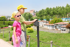 Brother and sister look at Traditional Turkish houses Royalty Free Stock Photos