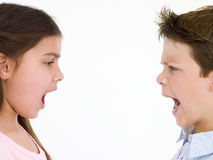 Brother and sister looking at each other shouting Royalty Free Stock Photos