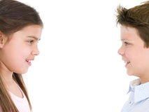 Brother and sister looking at each other smiling Royalty Free Stock Photo