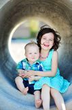 Brother And Sister Love. Six year old girl and her one year old brother smiling and hugging outside Stock Photography