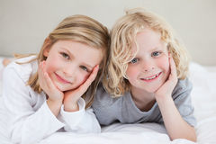 Brother and sister lying on the bed Royalty Free Stock Images