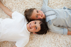 Brother and sister lying on the floor Royalty Free Stock Images