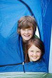 Brother And Sister Lying In Tent Royalty Free Stock Photo