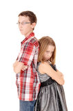 Brother and sister mad. A tall brother and small sister standing back to back isolated for white Stock Photography