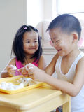 Brother and sister making dumplings Stock Photo