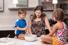 Brother and sister making a pie Royalty Free Stock Photography